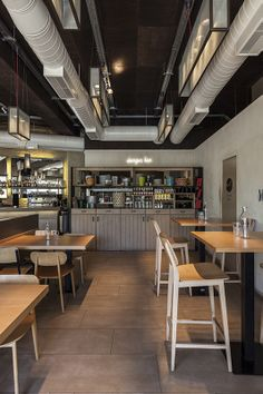 Industrial burger house open kitchen designed by Stones and Walls