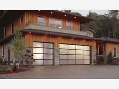 Bronze anodized aluminum garage door with obscure, frosted glass - Home and Garden Design Ideas