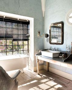 captivating bathroom from her home in Marbella, a city located next to the Mediterranean Sea on the southern tip of Spain. With all of the beautiful antiques and reclaimed pieces filling the space, you'd never know the room was actually new construction. I especially love the old trader's desk turned into a vanity.