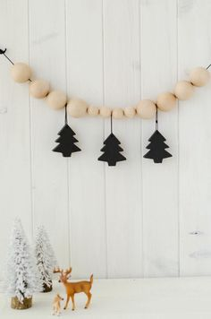 Hang ornaments from a string of wooden beads for a modern garland that would look totally at home in a Scandinavian cabin.