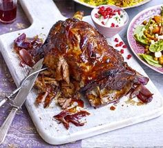 Pulled lamb shoulder with sticky pomegranate glaze. Cooking the meat really slowly in fruit juice makes it meltingly tender, and the juices double up as a sweet glaze