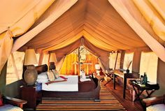 Here's to hoping that Somalisa Camp is in my 2015 safari itinerary. One of twenty beds at Somalisa Camp, situated in a grove of acacia trees in Hwange National Park. African Safari, African Animals, Moving To The Uk, Park Landscape, Victoria Falls, Camping Glamping, Tiny House Living, Cozy Place, Lodges
