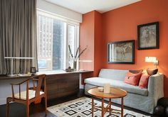 Office & Workspace: Contemporary Home Office In New York With Orange Coupled With Grey Drapes Sofa And Rug Also Classic Wooden Chair Round Table And Cabinet: Trendy and Gorgeous Orange Home Office Design Ideas Orange Rooms, Living Room Orange, Bedroom Orange, Living Room Grey, Bedroom Black, Gray Home Offices, Home Office Design, Orange Accent Walls, Orange Office