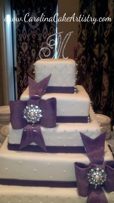 Purple Bows with Broaches wedding Cake!