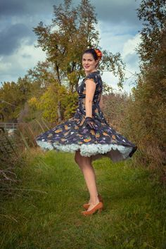Vintage blogger RetroCat wearing a 50s inspired swing dress by Hell Bunny for Halloween
