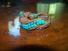 This is a new turquoise and sterling leather wrap bracelet.  It is a double wrap which means it goes around twice.  I twisted it, but you don't have to.