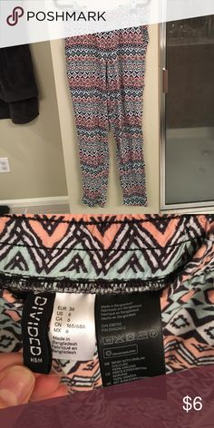 H & M flowy pants Good condition! Will be cute for spring. Slightly tapered at ankle, elastic waist Divided Pants Wide Leg