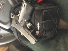 Kimber .45 Officers 1911. It sits in my go bag.