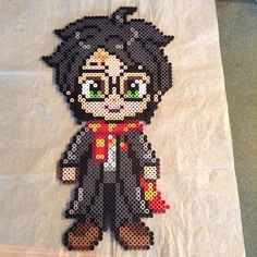Harry Potter perler beads by (original pattern by geekmythologycrafts) Melty Bead Patterns, Pearler Bead Patterns, Perler Patterns, Beading Patterns, Harry Potter Perler Beads, Perler Bead Mario, Modele Pixel Art, Peler Beads, Iron Beads