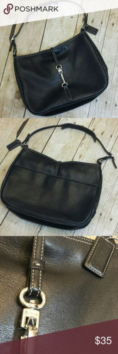 """Coach Vintage Black Leather Shoulder Bag Coach vintage black leather shoulder bag. Vintage coach all leather with silver clasp closure. Coach engraved on clasp and on the side. Some fading to the leather on the piping especially. Some surface scratches to the leather (typical Coach wear) Espresso satin interior with one zip inside pocket. Zip top closure with coach hangtag.   Measurements  10.5"""" long 8.5"""" tall 2.5"""" wide 8"""" drop Coach Bags Shoulder Bags"""