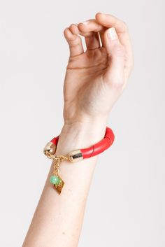 19 edition of the handcuff bracelet is made of red leather with gold plated metal components with aventurine or leather tassel. Leather Tassel, Red Leather, Galvanized Metal, Bracelet Designs, Statement Jewelry, Handmade Bracelets, Bracelet Making, Chain, Gold
