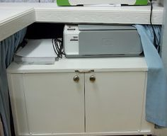 Craftaholics Anonymous®   Craft Room TOUR with Scrap This, Save That. Goodwill cabinet painted and set on wheels, tucked under craft counter. Especially appreciate the handle to easily pull it out.