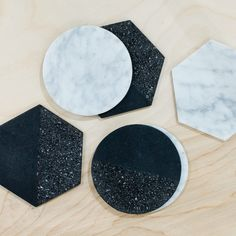 Coaster gift set, handcrafted in Mexico by Peca Design Studio, set of 6 with three white marble and three black volcanic rock pieces - even mix of hexagons and circles, coasters have cork backings, $55