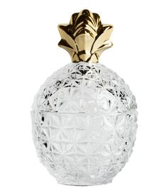 Clear glass. Pineapple-shaped glass jar with a silver-colored finish and a lid. Diameter approx. 4 in., height 6 3/4 in.