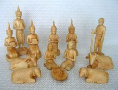 "Cambodian Nativity set carved by disabled Buddhist artisans from Dai Khla (""Tiger Hand""), a native wood.  This tree doesn't grow straight up but grows around other trees.  There are two angels (Khmer style with fancy pointed headdress."