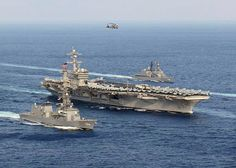 USS Carl Vinson and Japan Maritime Self-Defense Force ships steam in formation at the conclusion of a bilateral exercise to increase proficiency in basic maritime skills and improve response capabilities, Mar. 29, 2017. The Carl Vinson is on a regularly scheduled Western Pacific deployment. Japan Maritime Self-Defense Force photo