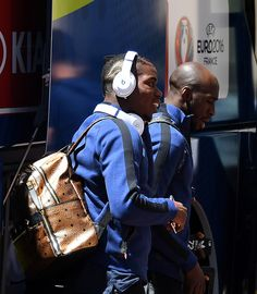 France's midfielder Paul Pogba (L) and France's defender Eliaquim Mangala (R) arrive at the hotel in Marseille, on June 14, 2016, on the eve of the Euro 2016 European football match against Albania.  / AFP / FRANCK FIFE