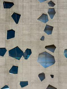 Angular openings puncture concrete facades of Lucio Morini's university tower Modern Architecture Design, Commercial Architecture, Facade Design, Facade Architecture, Sustainable Architecture, Modern House Design, Amazing Architecture, Wall Design, Concrete Facade