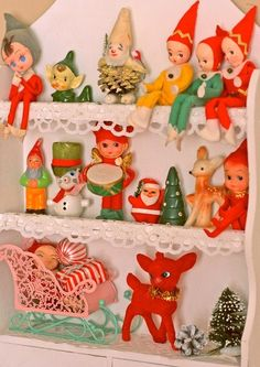 Kitschy Living - lots of cute elves on 3 tiny shelves