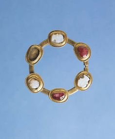 Cameos: mid-13th century; brooch: c. 1320-24. Found at Oxwich Castle, Wales. National Museum of Wales, Cardiff.