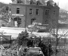 https://flic.kr/p/eZnkk5 | Jagdtiger 331 | Jagdtiger 331 was left in the middle of the street, while Jagdtiger 323 was parked in a courtyard opposite. Both vehicles had been abandoned due to damage to their final drives, probably as a result of a battle in Neustadt an der Weinstrasse on 22 March in which the 3rd Kompanie destroyed several U.S. tanks. (U.S. Army)