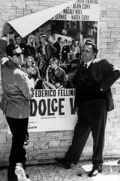 Marcello Mastroianni and Federico Fellini putting up a poster for La Dolce Vita