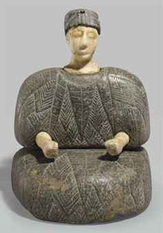 A BACTRIAN COMPOSITE STONE SEATED FEMALE FIGURE