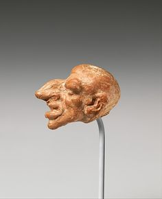 Terracotta head of a male dwarf,Hellenistic. 2nd century BC Greek