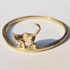 And this one...'Cat on a hot tin roof' ring by Verameat $40 in brass http://www.verameat.com/collections/finger-1/products/cat-on-a-hot-tin-roof