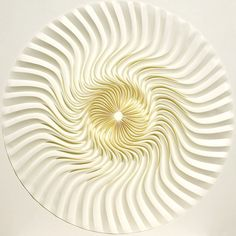 Japanese artist Yuko Nishimura reworks single sheets of handmade paper into abstract, contoured works of art in her series labeled as Relief. She employs the paper folding techniques used in origami to transform the special Japanese paper known as kyokushi into mesmerizing geometric patterns.