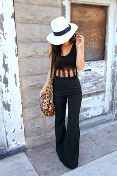 Hat. Perfectly tailored pants. Not sure about that tassled mess on top.