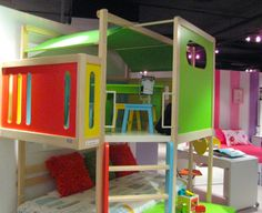 Kids loft bed.  I LOVE that the play space is above the bed on this one!