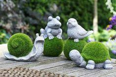 Betontiere mit Gras
