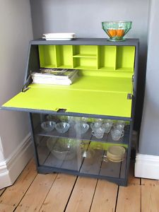 Turn an old secretary style desk in an adorable hidden bar!  Glassware and bottles below - mixing utensils tucked neatly away but at easy access when entertaining.  VG