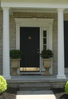 Door color and kick plate with urns .The Yellow Cape Cod: 31 Days of Building Character: More On The Door Black Exterior Doors, Painted Exterior Doors, Painted Front Doors, Black Doors, Black Windows, Front Door Hardware, Front Door Handles, Gold Hardware, Yellow Front Doors
