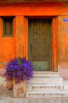 Orange and blue work because they're opposite on the color wheel. Don't be afraid to take color beond the typical. Kipseli, Athens // by GEO K on All things Hellenic Door Knockers, Door Knobs, When One Door Closes, Tore, Portal, Closed Doors, Doorway, Stairways, Windows And Doors