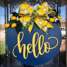 """Round (16"""" x 16"""") Hello door hanger with lemon ribbon and floral accents. Round is slightly distressed. Hello text is cut out of wood. Color options at checkout are navy, black or yellow wooden circle, but I'm happy to customize to other colors. Just send me a message! Unless otherwise indicated in Wooden Door Signs, Wooden Welcome Signs, Wooden Door Hangers, Wooden Doors, Wood Crafts, Paper Crafts, Diy Crafts, Spring Door, Spring Summer"""