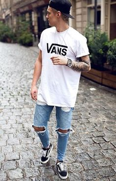 white tshirt from vans styled with light blue ripped jeans and sneakers