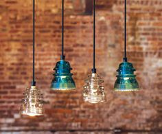 Recycling Glass Insulators Into Pendant Light. This would be a wonderful use of the kids ( now grown) glass insulators we have tons! Insulator Lights, Glass Insulators, Electric Insulators, Jar Lights, Glass Lights, Bottle Lights, Chandeliers, Do It Yourself Upcycling, Napa Style