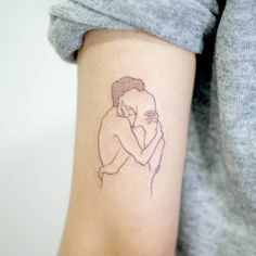 Hug tattoo on the back of the left arm. Tattoo artist: Doy