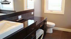 Bathroom vanity with dark granite counter tops