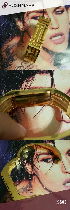Tory Burch FITBIT Caged Bangle Bracelet I have a Fabulous Tory Burch fitbit caged bracelet.. In gold plated metals.. Good condition! Has a few scratches from use.. Small compartment holds your Fitbit in place without compromising style.  This is made especially for the Fitbit Flex first generation! Authentic! Tory Burch Jewelry Bracelets