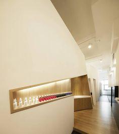Estetica Headquarters in Singapore by Studio SKLIM