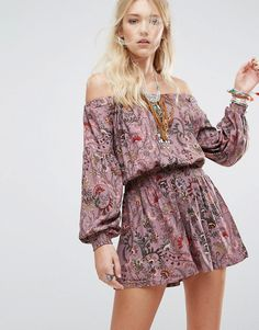 Buy it now. Free People Pretty and Free One Piece - Purple. Playsuit by Free People, Lightweight woven fabric, Floral print, Stretch Bardot neck, Cut-out back, Regular fit - true to size, Machine wash, 100% Rayon, Our model wears a UK S/EU S/US XS and is 181cm/5'11.5 tall. With roots back to the �70s, the Free People girl lives through art, fashion, music and wanderlust. She�s feminine in spirit and Bohemian in attitude. From sweet to tough, tomboy to romantic, Free People mishmash colour...