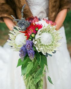 Cascading bouquet with protea