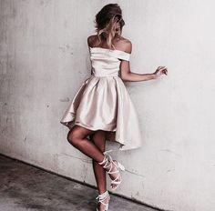 Champagne off the shoulder dress.