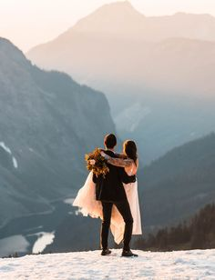 Rugged Backpacking North Cascades Elopement through the snow and mountains with dogs for a mountain top sunset