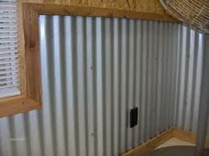 corrugated metal wall -- bottom portion of wall only trimmed out with standard lumber