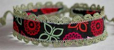 Comfortable, adjustable, #headband with ties made from black fabric with green crocheted trim and ties, accented with red, orange, pink and green. #group2020