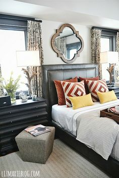 mix of burnt oranges & yellows in the master bedroom.